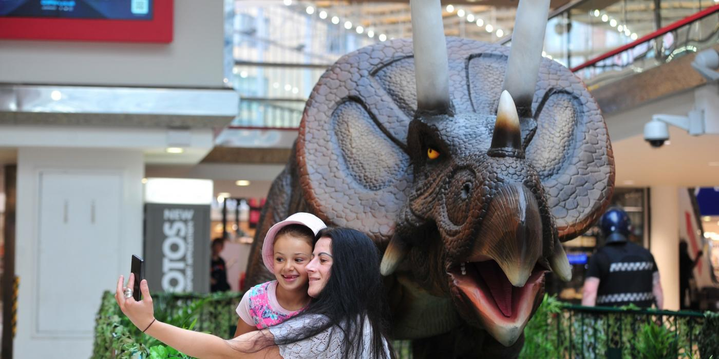 Family taking a photo with a dinosaur in the Merrion Centre